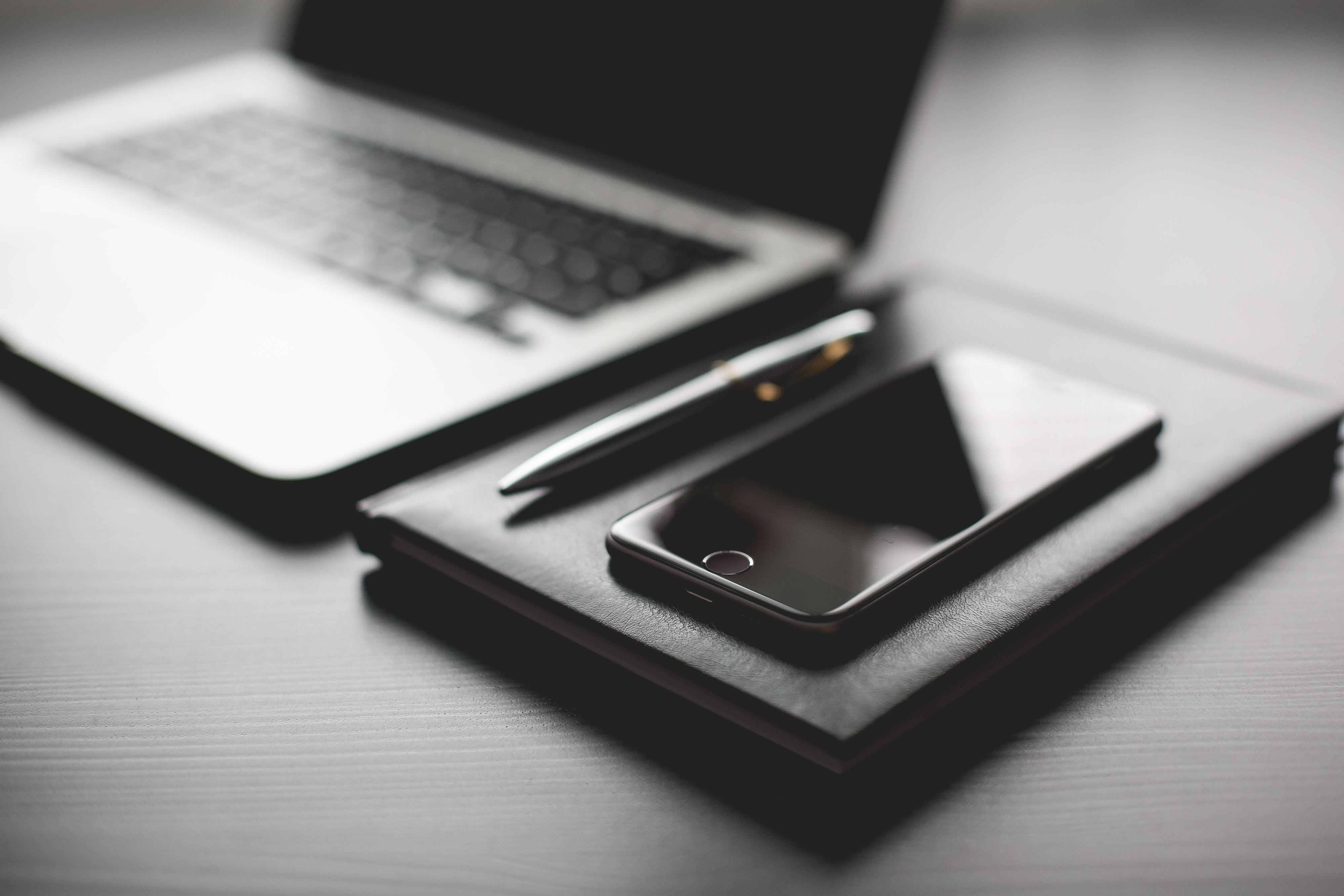 all-black-working-setup-diary-and-iphone-picjumbo-com-1