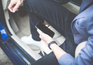 man-holding-iphone-in-his-car-picjumbo-com
