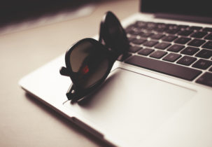 style-sunglasses-with-macbook-picjumbo-com