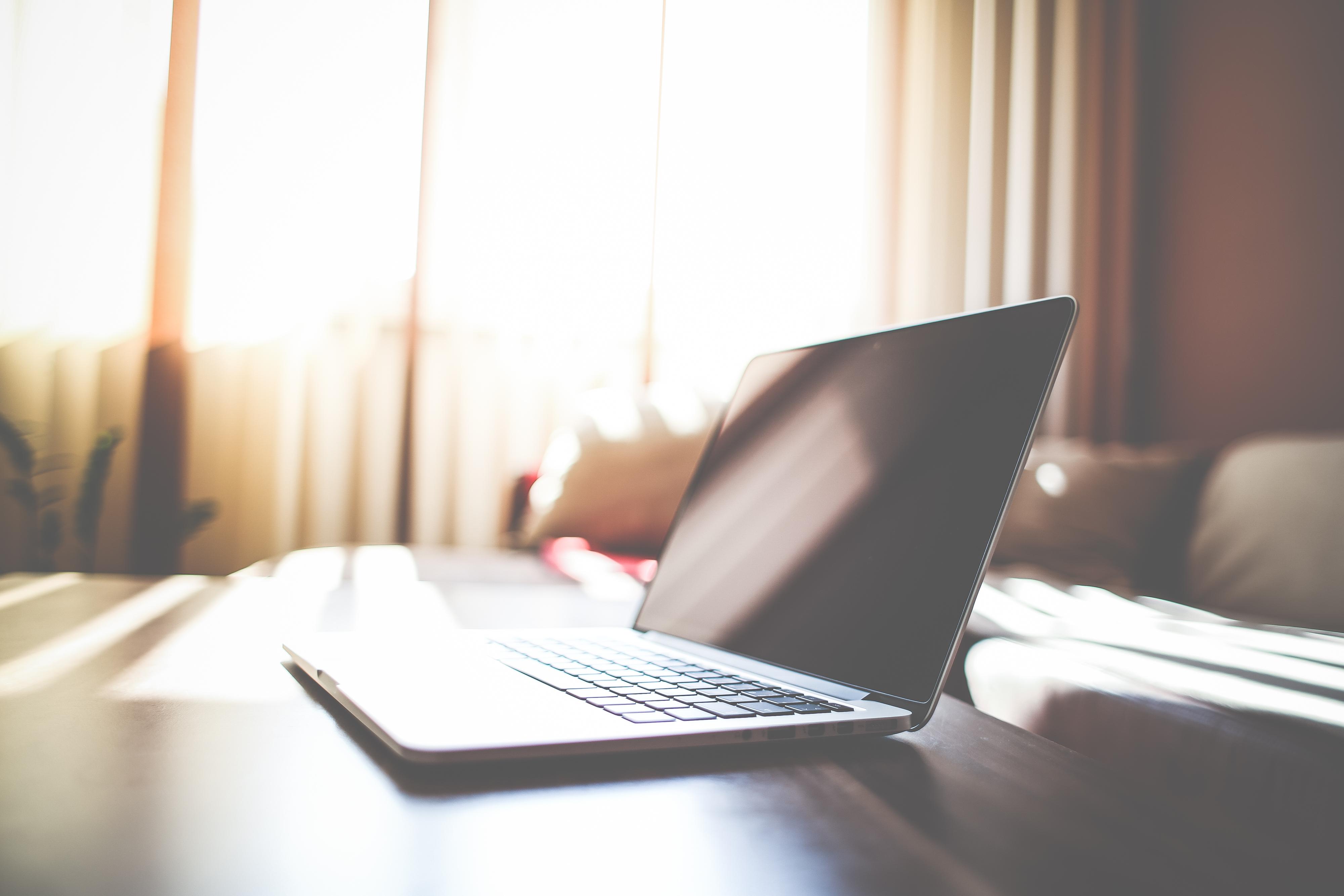 macbook-on-living-room-table-picjumbo-com