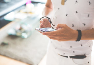 man-working-on-iphone-while-walking-picjumbo-com