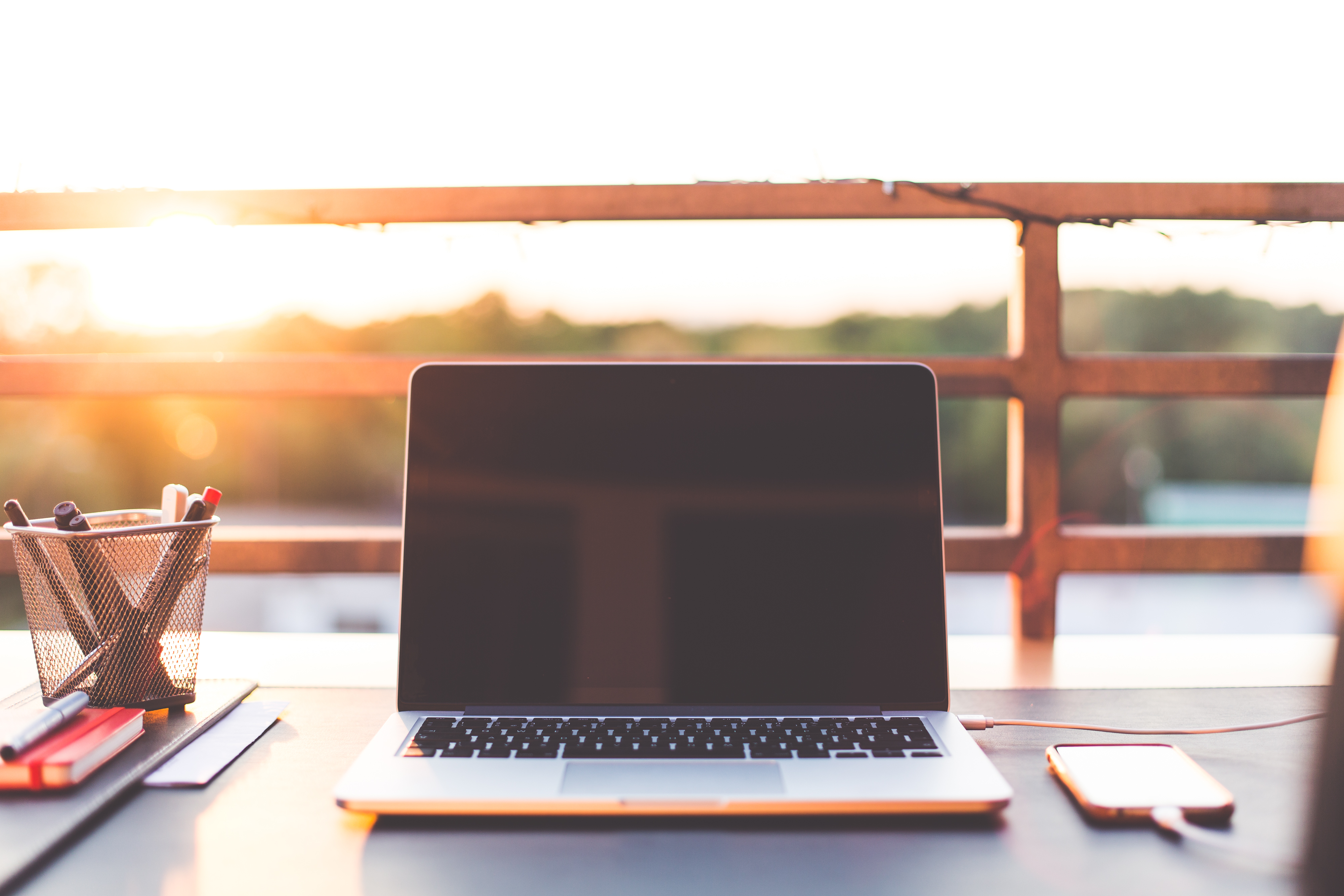 sunset-home-office-working-with-laptop-on-the-garden-picjumbo-com