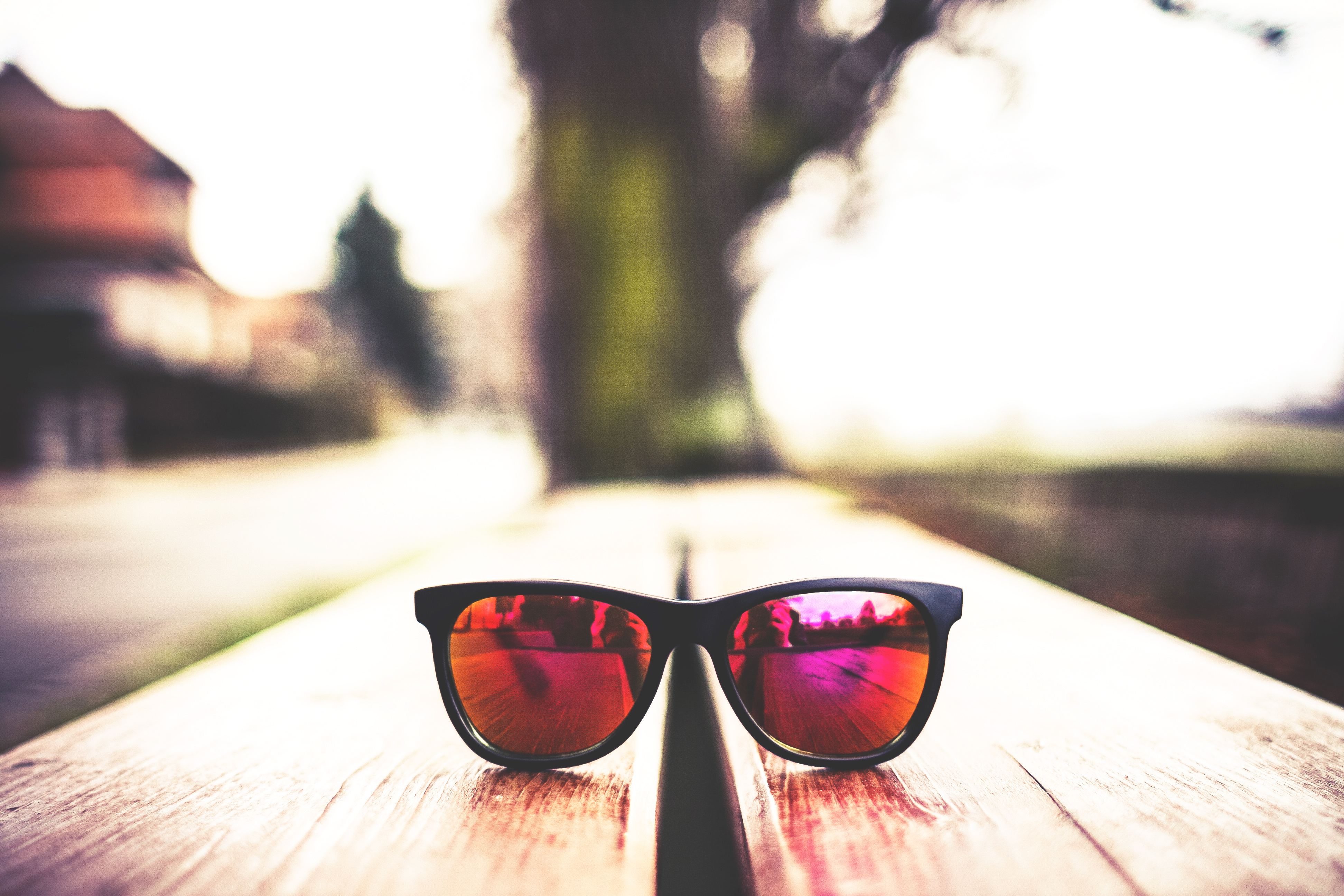 red-fashion-glasses-on-wooden-table-picjumbo-com